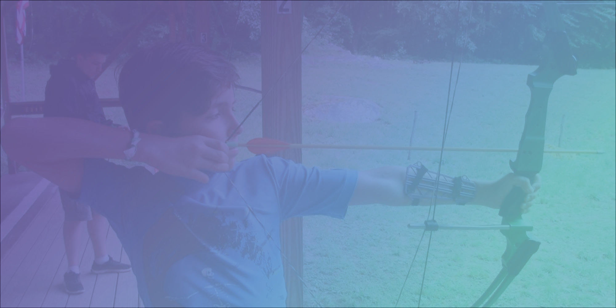 banner image: boy with bow and arrow practicing archery