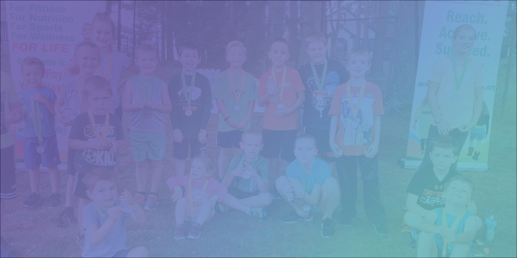 banner image, smiling kids with medals